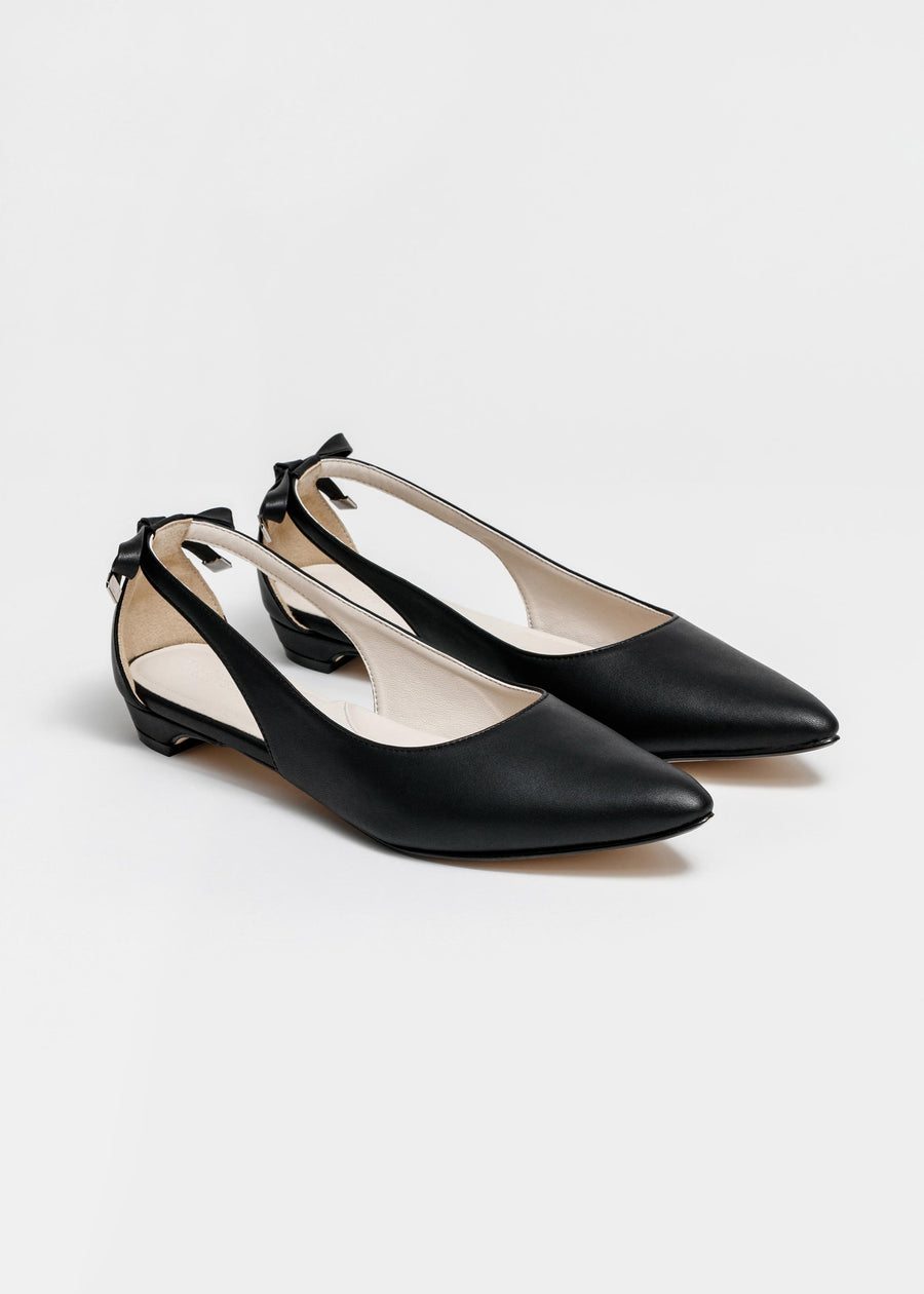 Taffystep The Gummy. Black ballet flats with a subtle pointy toe and a delightful bow detail on the back. Made with a soft microfiber vegan leather and cushioned insole. Designed in Vancouver, Canada.