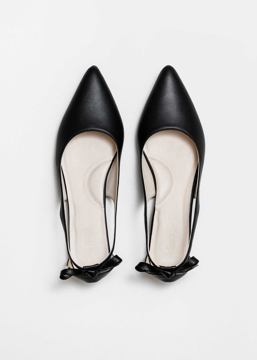 Taffystep The Gummy. Black ballet flats with a subtle pointy toe and a delightful bow detail on the back. Made with a soft microfiber vegan leather and cushioned insole. Birdview of the Shoes. Designed in Canada.