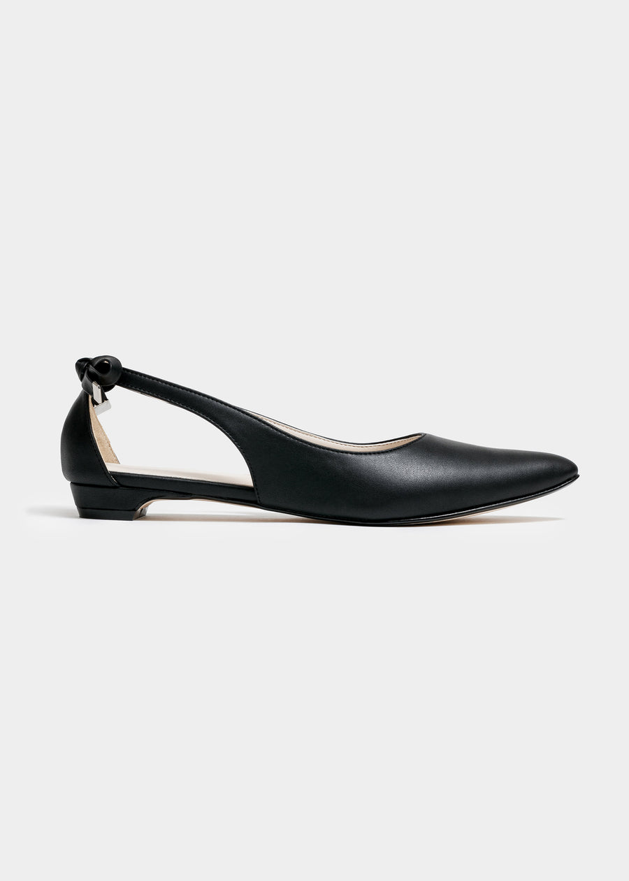 Taffystep The Gummy. Black ballet flats with a subtle pointy toe and a delightful bow detail on the back. Made with a soft microfiber vegan leather and cushioned insole. Side View of the flat. Designed in Canada.