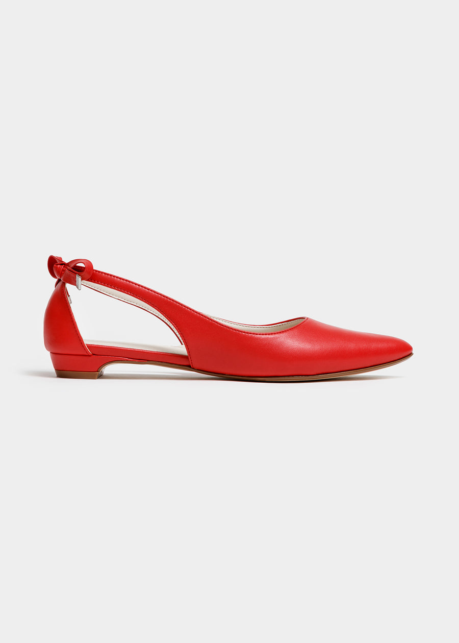 Taffystep The Gummy. Red ballet flats with a subtle pointy toe and a delightful bow detail on the back. Made with a soft microfiber vegan leather and cushioned insole. Side View of the flat. Designed in Vancouver, Canada.