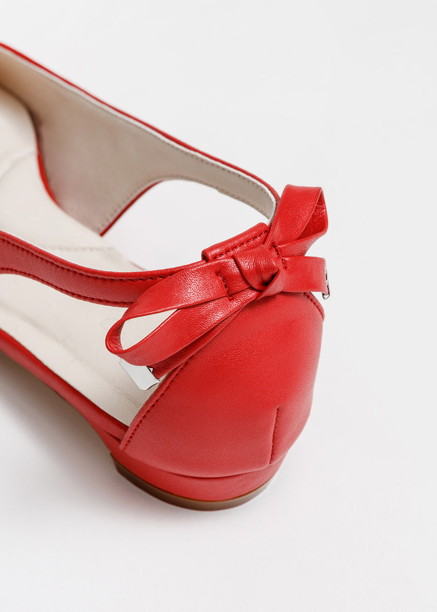 Taffystep The Gummy. Red ballet flats with a subtle pointy toe and a delightful bow detail on the back. Made with a soft microfiber vegan leather and cushioned insole. Deigned in Vancouver, Canada.
