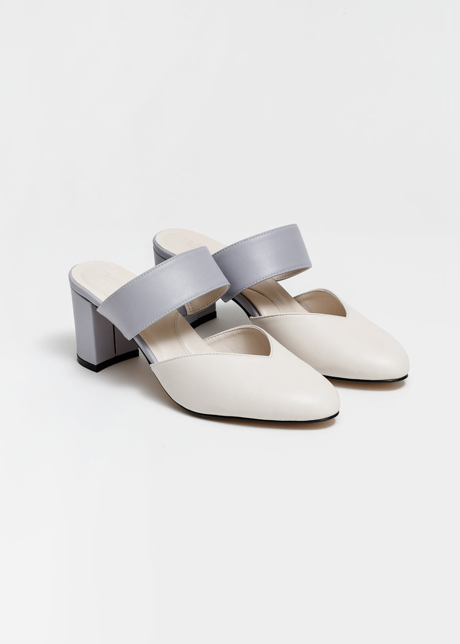 Taffystep The Smartie Mules. Cream and Lilac mules with stylish pointy toe, a subtle V-cut opening and a walkable block heel will bring you all-day comfort and takes you from work to play.  Made with a soft microfiber vegan leather and cushioned insole. Designed in Vancouver, Canada.