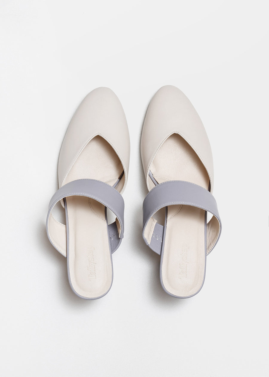 Taffystep The Smartie Mules. Cream and Lilac mules with stylish pointy toe, a subtle V-cut opening and a walkable block heel will bring you all-day comfort and takes you from work to play. Made with a soft microfiber vegan leather and cushioned insole. Birdview of the Shoes. Designed in Vancouver, Canada.