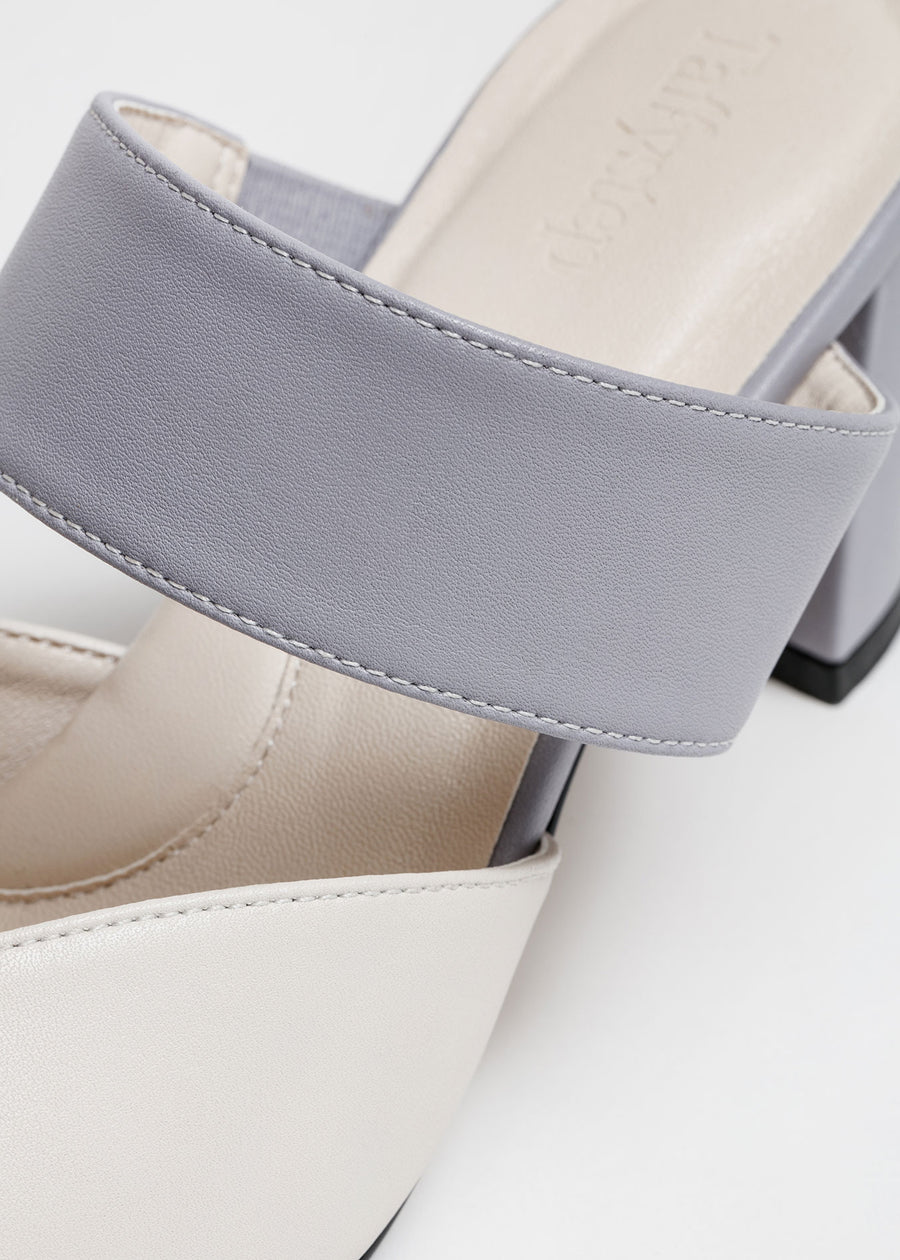 Close up shot. Taffystep The Smartie Mules. Cream and Lilac mules with stylish pointy toe, a subtle V-cut opening and a walkable block heel will bring you all-day comfort and takes you from work to play. Made with a soft microfiber vegan leather and cushioned insole. Designed in Vancouver, Canada.