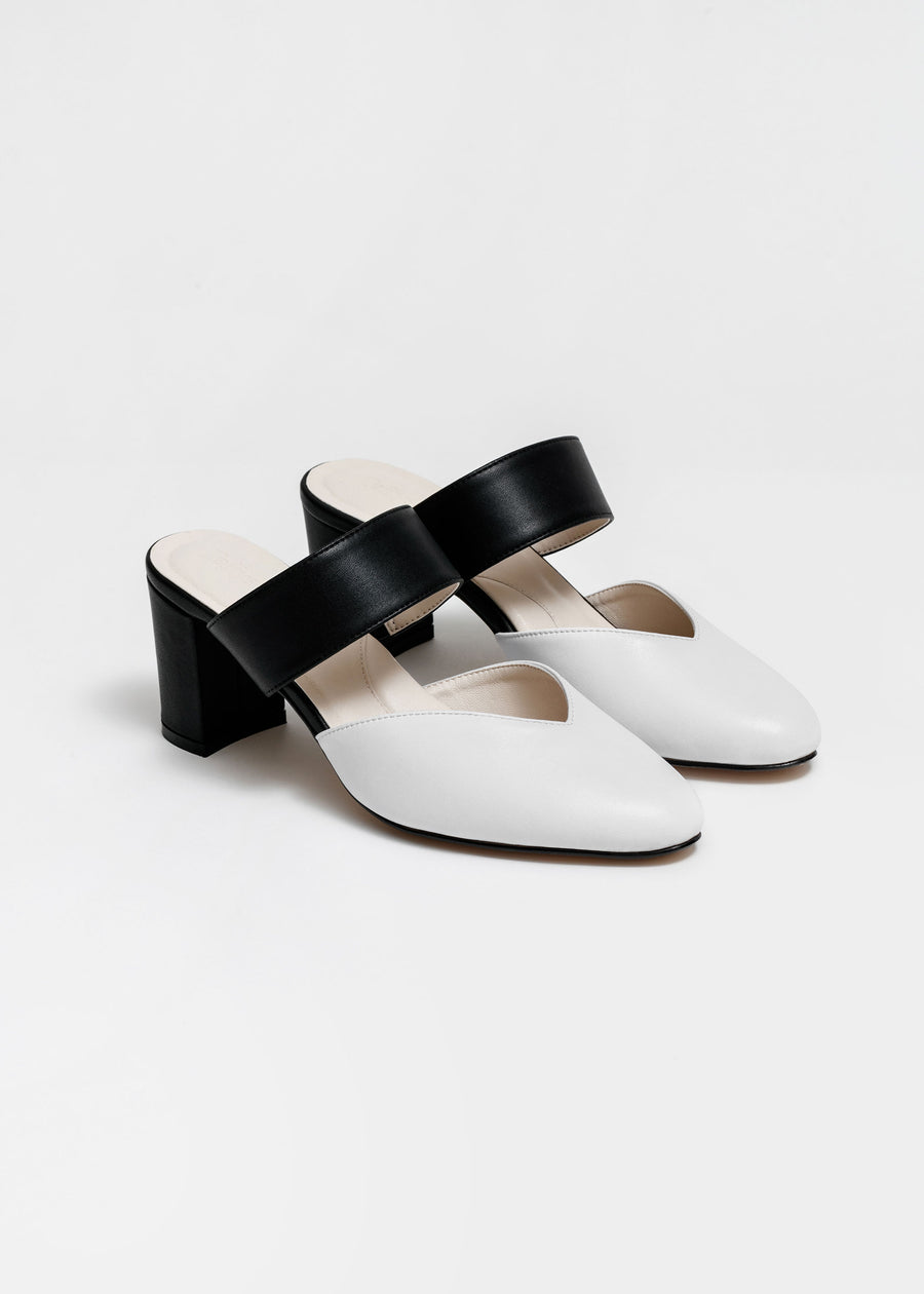 Taffystep The Smartie Mules. Black and white mules with stylish pointy toe, a subtle V-cut opening and a walkable block heel will bring you all-day comfort and takes you from work to play. Made with a soft microfiber vegan leather and cushioned insole. Designed in Vancouver, Canada.
