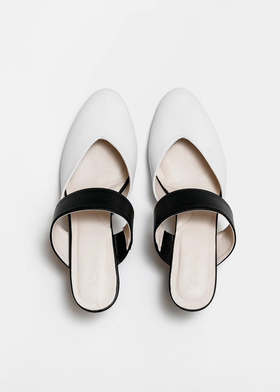Taffystep The Smartie Mules. Black and white mules with stylish pointy toe, a subtle V-cut opening and a walkable block heel will bring you all-day comfort and takes you from work to play. Made with a soft microfiber vegan leather and cushioned insole. Birdview of the Shoes. Designed in Vancouver, Canada.
