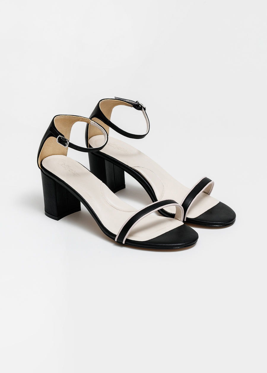 Taffystep The Tootsie Heels. Modern and minimalist vegan leather ankle-strap sandal with a chic detail. The Tootsie features chunky block heels and breathable cushioned insole that makes the day-to-day walking a breeze. Designed in Vancouver, Canada.