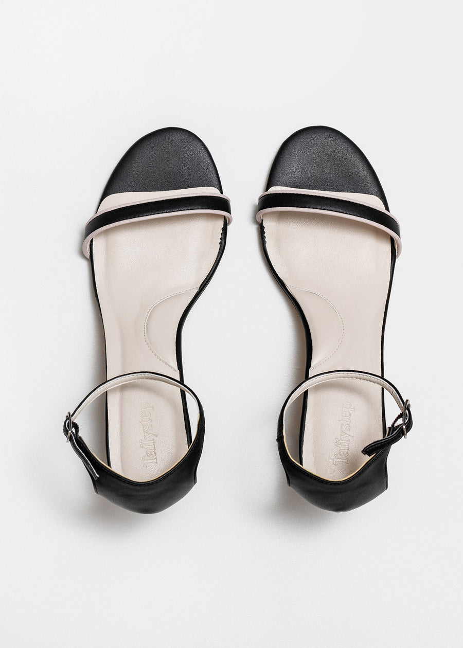 Taffystep The Tootsie Heels. Modern and minimalist vegan leather ankle-strap sandal with a chic detail. The Tootsie features chunky block heels and breathable cushioned insole that makes the day-to-day walking a breeze. Birdview of the Shoes. Designed in Vancouver, Canada.