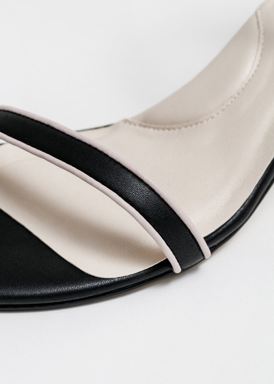 Close up shot. Taffystep The Tootsie Heels. Modern and minimalist vegan leather ankle-strap sandal with a chic detail. The Tootsie features chunky block heels and breathable cushioned insole that makes the day-to-day walking a breeze. Designed in Vancouver, Canada.