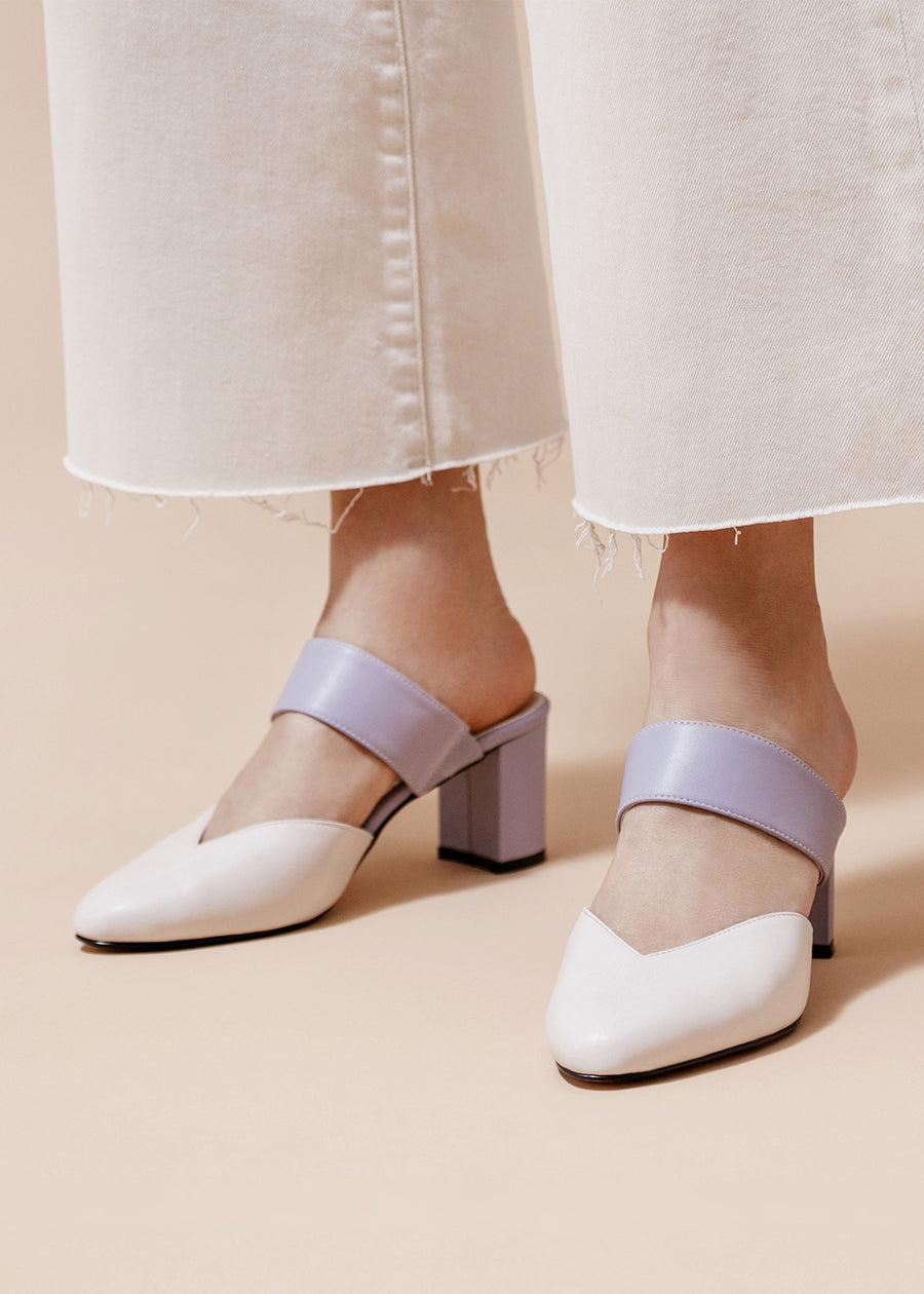 Model inwhite jean and the Smartie mules. Taffystep The Smartie Mules. Cream and Lilac mules with stylish pointy toe, a subtle V-cut opening and a walkable block heel will bring you all-day comfort and takes you from work to play. Made with a soft microfiber vegan leather and cushioned insole. Designed in Vancouver, Canada.