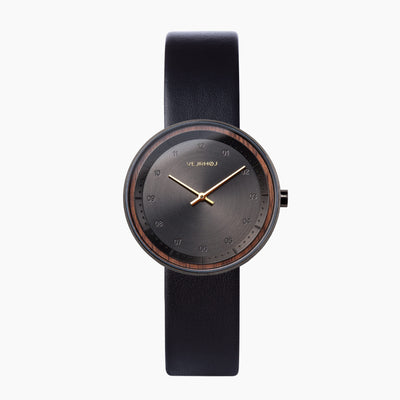 lady's black gold watch
