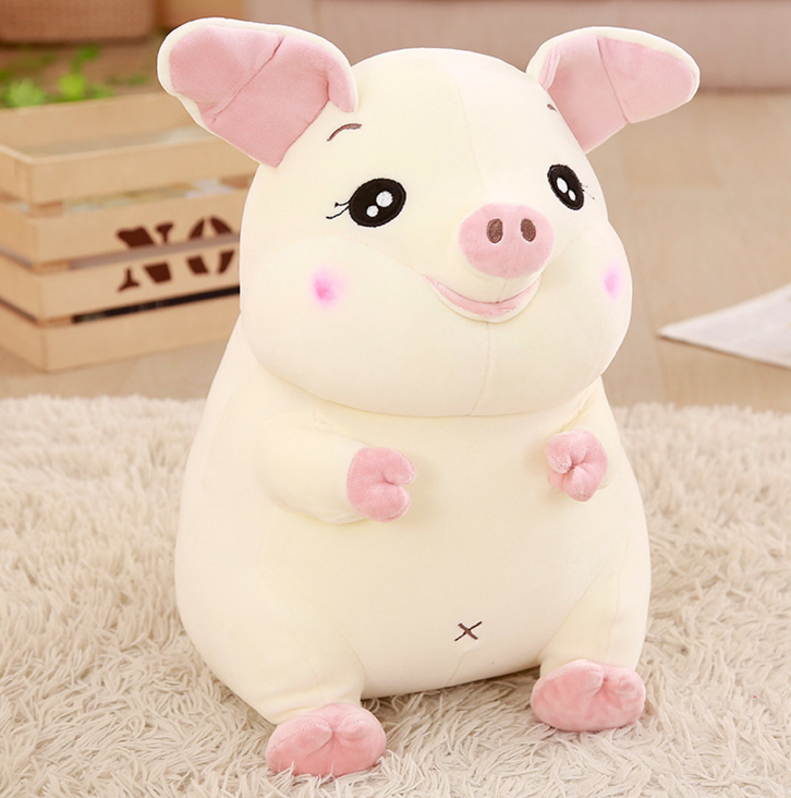 Grosse peluche cochon attachant