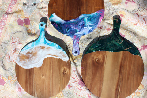 3 large round shaped boards with a wave like edge of resin