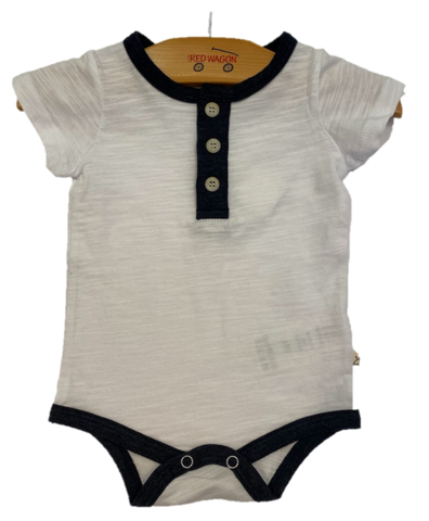 Soft white onesie with navy detailing, 3 buttons, and snap closure