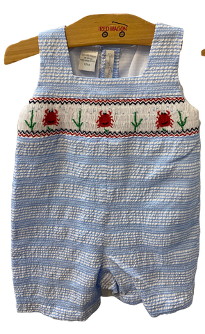 blue and white striped seersucker romper with a crab design