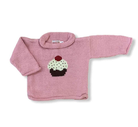 pink roll neck sweater with cupcake on front center, cupcake has brown bottom with white icing with brown sprinkles and red cherry on top