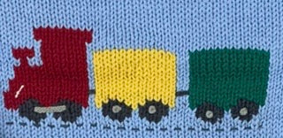 close up of train knitted design with red car at front, yellow car in middle and green car at end
