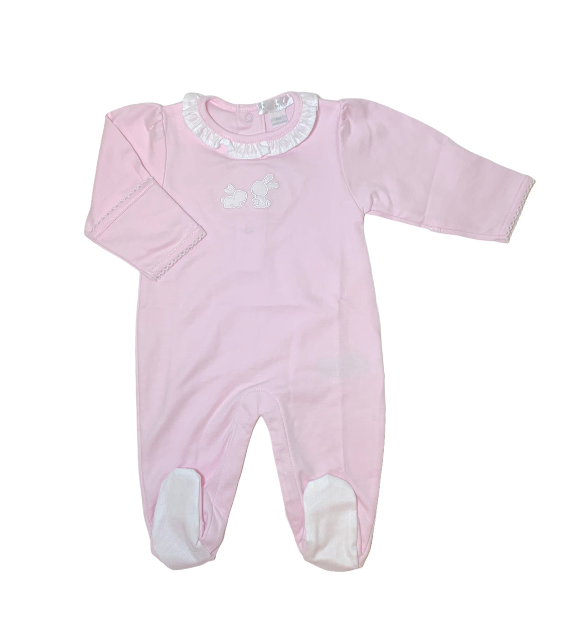 light pink footie with white bunny on top center, white ruffle around neckline, white fabric on bottom of feet