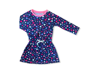 navy dress with pink, blue, purple, and white hearts all over, pink trim at neckline, white bow at waist