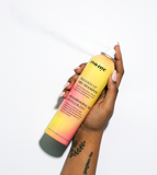 Eva NYC Freshen Up Dry Shampoo full size bottle spray in model hand