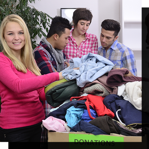Volunteer group sorting through a box of donated clothes.