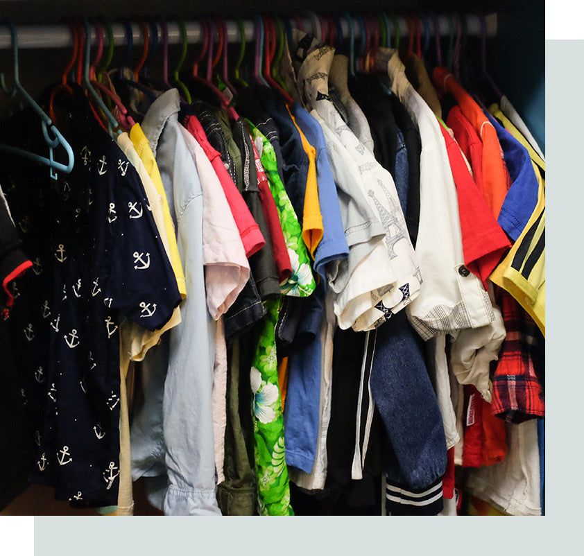 Closet full of clothes and shirts.