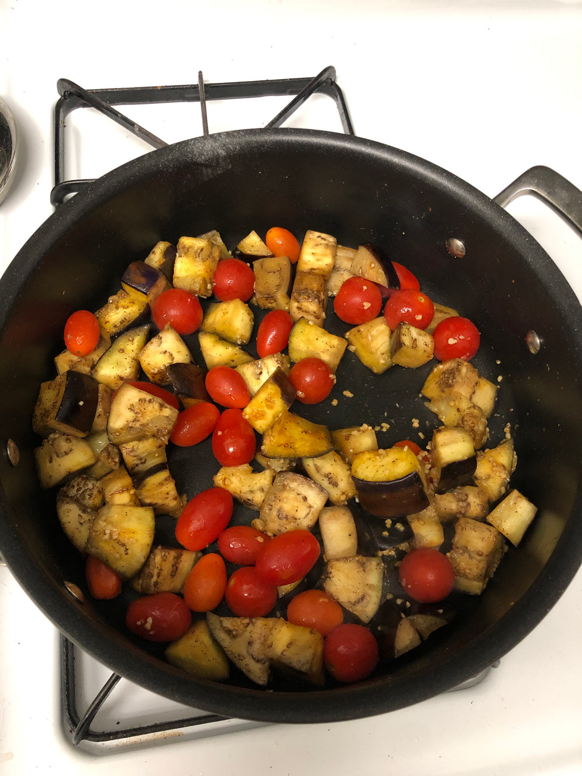 Eggplant and tomatoes in pan