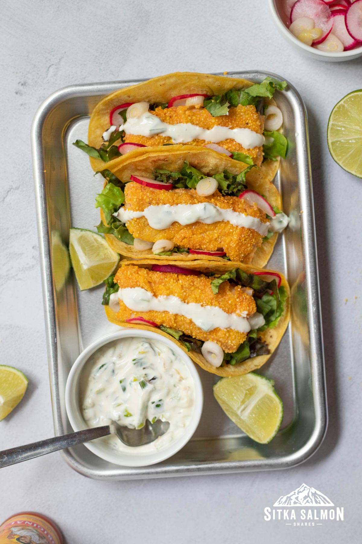 """Crusted Halibut Tacos with Charred Scallion Crema and """"Pickled"""" Onions and Radishes Recipe 