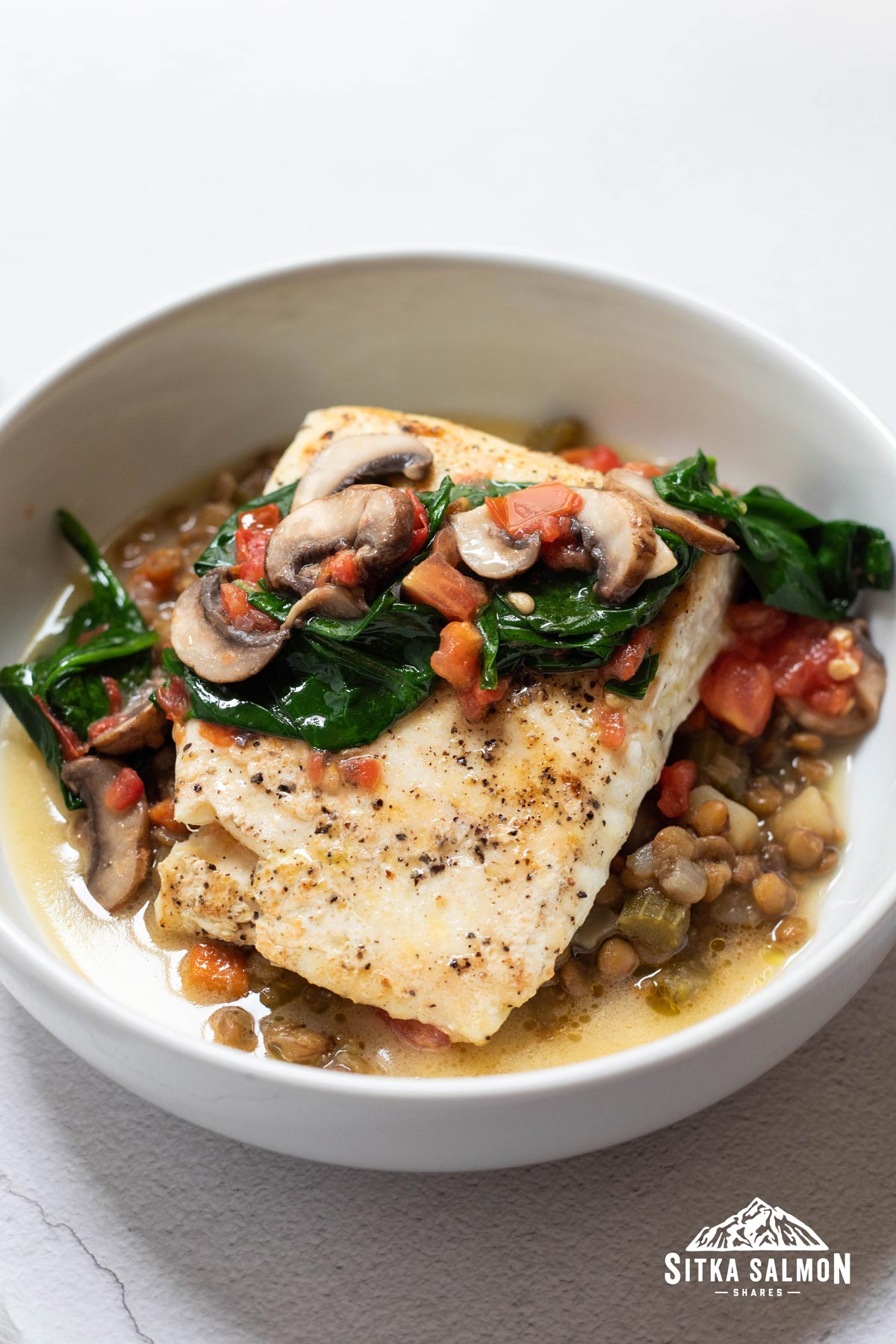 Halibut with Braised Lentils and Lemon Butter Sauce Recipe | Sitka Salmon Shares