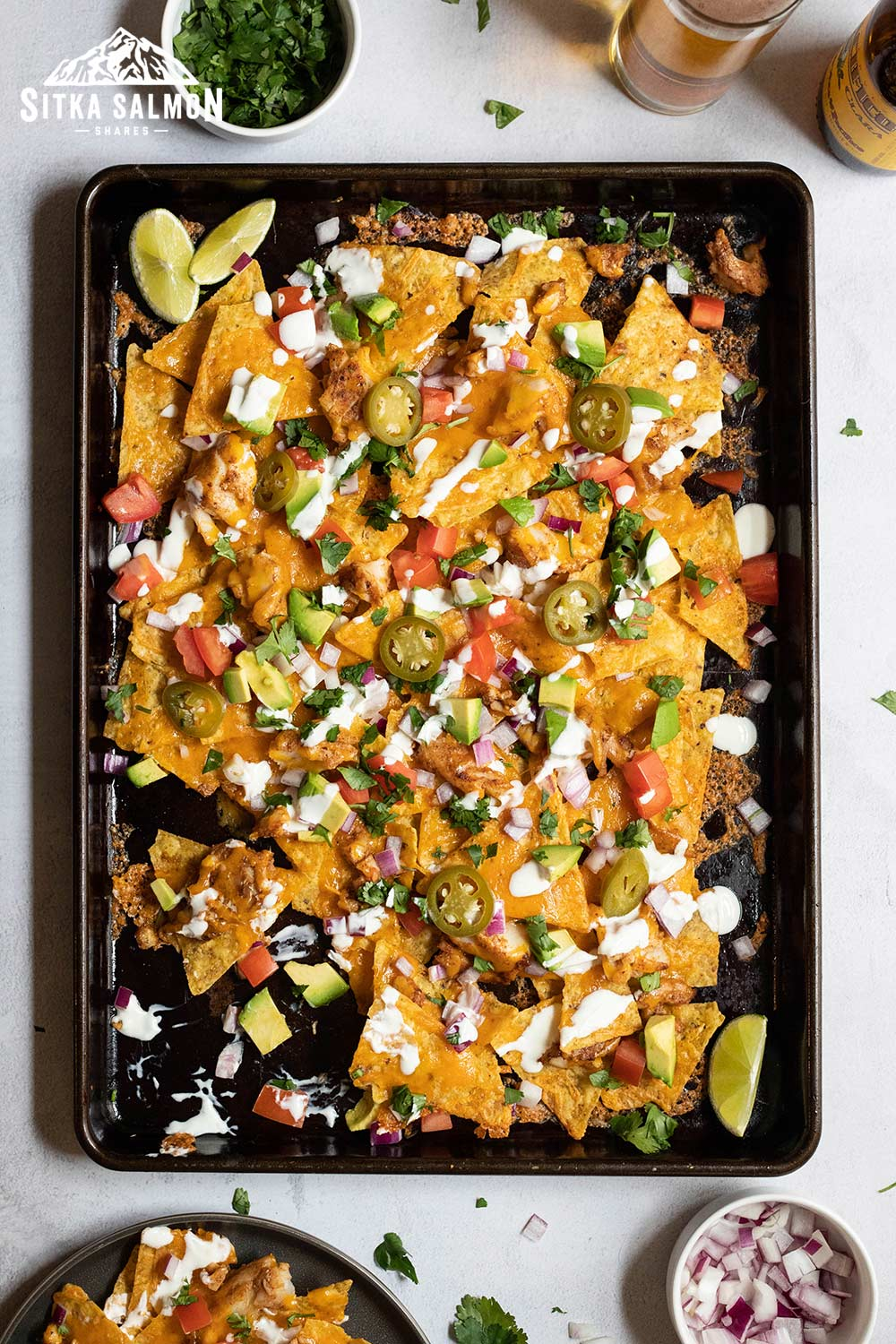 Spicy Fish Taco-Nachos with Lime Crema Recipe   Sitka Salmon Shares