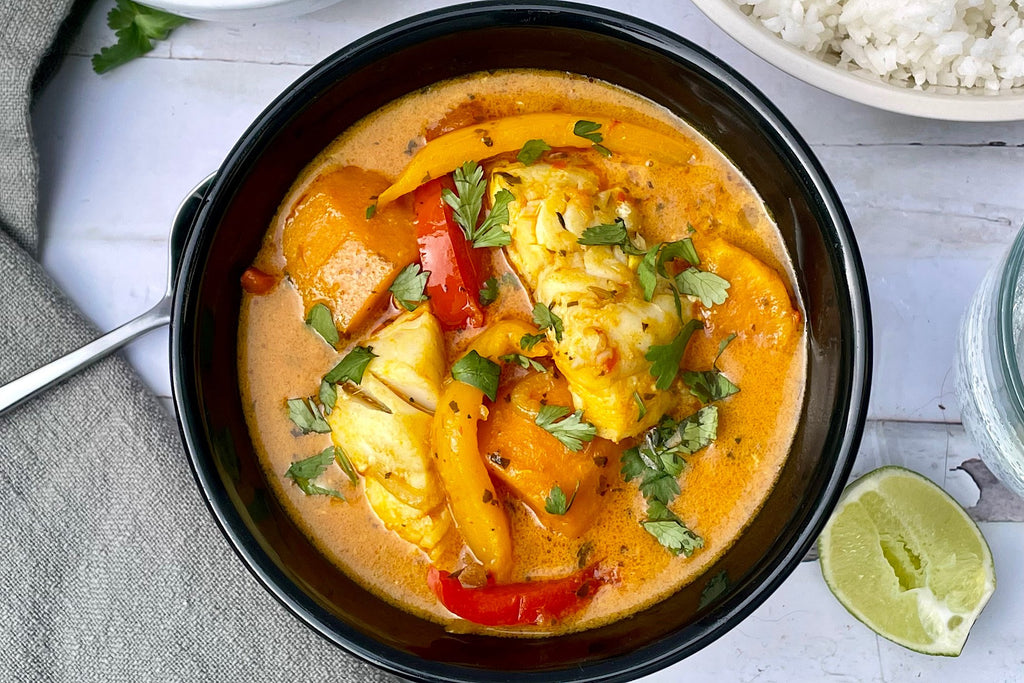 A plated dish of Dominican-style coconut Pacific Cod stew