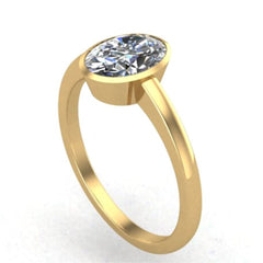 Musca oval bezel set moissanite ring