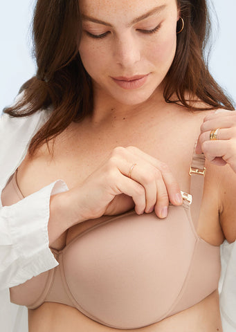 8719b3d08 Woman unclasping the 24 7 Classic Nursing Bra in an opened white shirt.