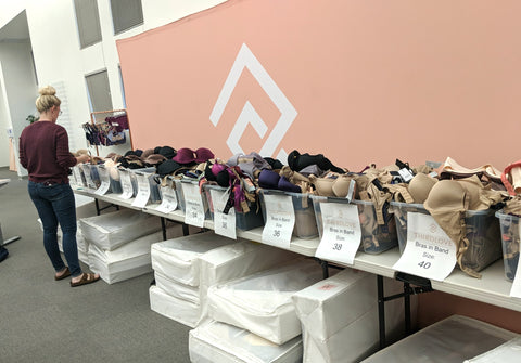 ThirdLove employee organizing bra donations for victims of the Camp Fires.