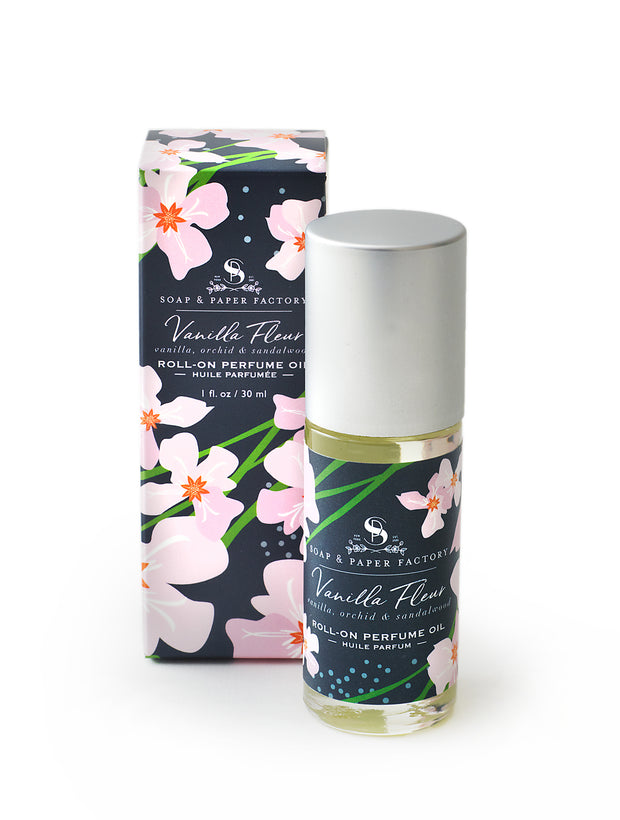 Body oil in Vanilla Fleur, Vanilla bean, Orchid & Sandalwood, made with pure jojoba oil and great for entire body as well as just use as a perfume oil on pressure points.  Large rollerball 1oz, with signature design, whimsy orchids on navy background. Made in USA