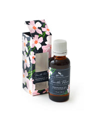 Vanilla Fleur fragrance oil is made from Vanilla bean, Orchid and Sandalwood. It's earthy, not a sweet foody vanilla . The oil is for plug in diffusers, wax melters and humidifiers.  A few drops in a hot tub is nice too. The oil is 1oz, and comes in a decorative box  with our signature design for Vanilla Fleur.  Whimsy vanilla orchids on a bold navy background.  Bottle is safely sealed and amber in color. Made in USA