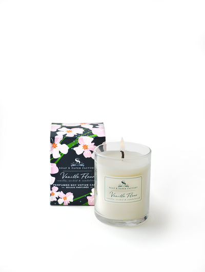 votive soy candle with notes of Vanilla bean, Orchid and Sandalwood. warming and earthy. Candle is pure soy, comes in 3oz clear glass cup, in a decorative box with our signature design of whimsy orchid flowers on a navy background . Made in NY.  Burns 20 hours. Made in USA
