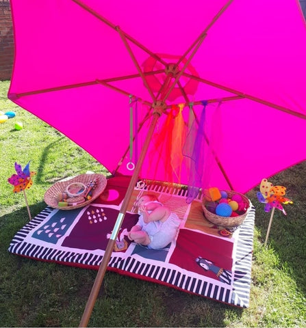 umbrella play for babies in the sun