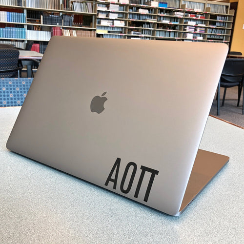 Alpha Omicron Pi laptop decal in gloss black
