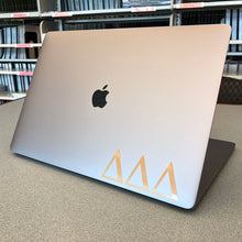 Load image into Gallery viewer, Delta Delta Delta laptop decal in gloss gold metallic