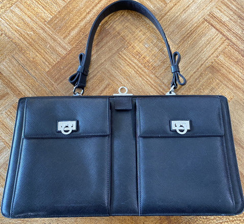 Ferragamo black pebble leather frame top bag