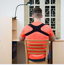 Load image into Gallery viewer, man sat at a desk wearing a back posture corrector
