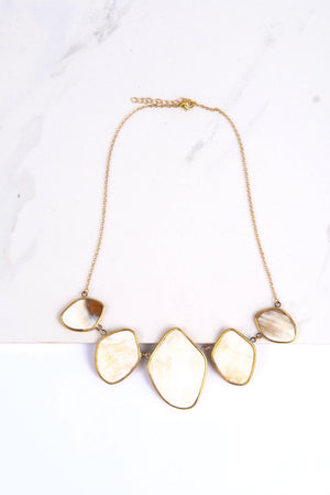 Adorable upcycled necklace in white background