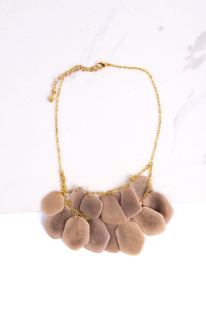Ethically made neutral stone treasure necklace made of dangling overlapping tagua seeds