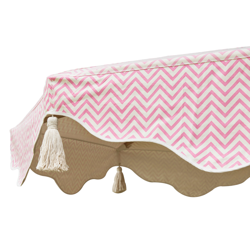 Pink Aretha Octagonal Parasol showing pink zig zap pattern on canopy and white tassels