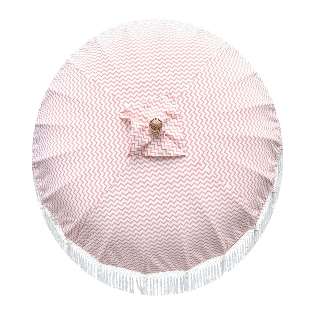 East London Parasol Kate- coral pink zig zag garden parasol with tassels in shades of white, hand made. The perfect garden umbrella for picnics, gardens, summer, patios, pool side and terraces.  Bali and Indian inspired garden parasol and luxurious designer garden feature.