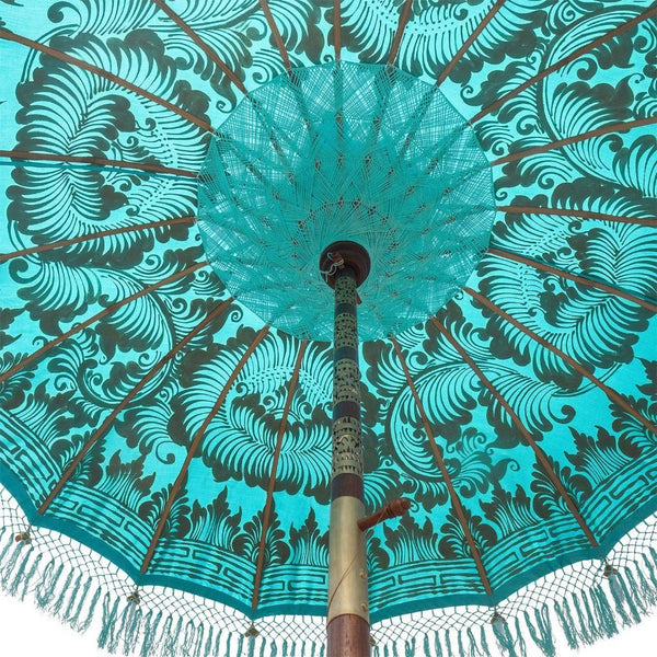 East London Parasol Company Bali Bamboo 2m garden umbrella. Bette- blue and gold with tassels. Handmade and handpainted with fringing and tassels in shades of blue.