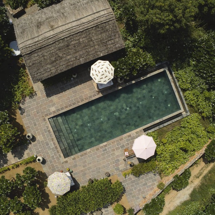Pink Aretha Octagonal Parasol aerial image over parasols by the pool