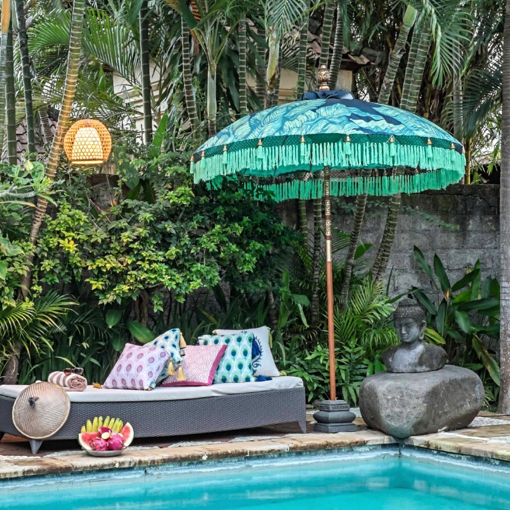 Nina- Navy blue waterproof canvas Bali garden parasol with palm print and banana leaf design. Beautiful umbrella perfect for a picnic, patio, through your table with an umbrella hole or by your sun lounger at the pool. Make your outdoor space chic, elegant and glamorous with this colourful tropical jungle summer decoration.