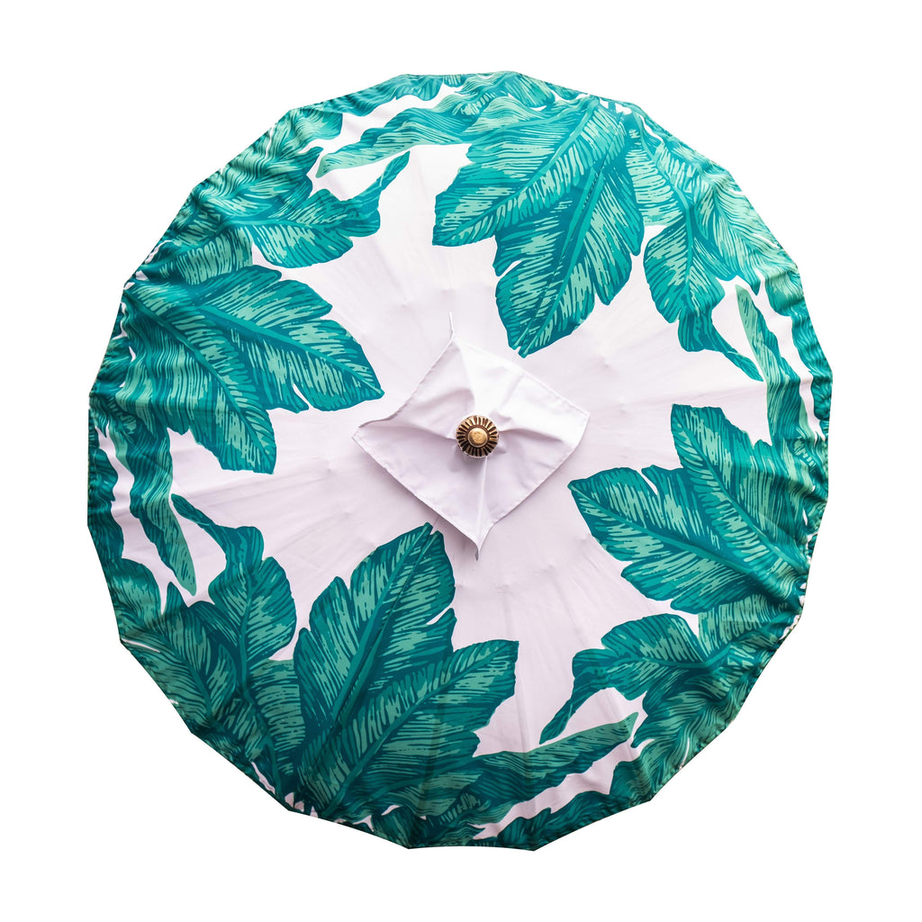 Meryl- green and turquoise palm print Bali waterproof parasol for a beautiful colourful garden. The most luxurious garden umbrella for a pretty pool side, bistro cafe table, deck chair and picnic. Flamboyant and stylish jungalow style tropical summer accessory. A pretty decoration for alfresco dining.